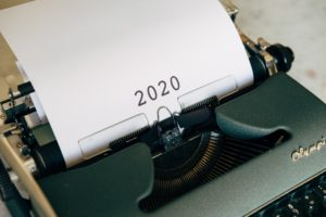 "a typewriter with ""2020"" printed onto the paper"